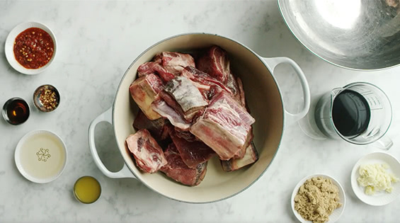 Place ribs and ingredients in Dutch oven.